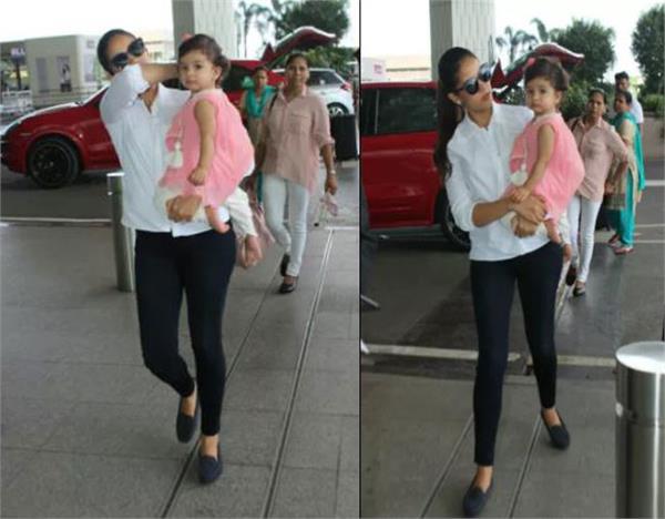 meera rajput with misha at airport