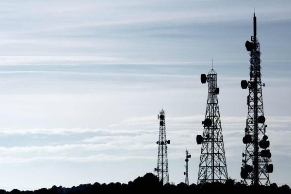 टेलीकॉम कंपनियों को मिल सकती है स्पेक्ट्रम कैप में छूट