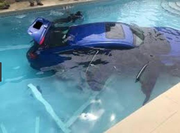 woman parked her car in the swimming pool