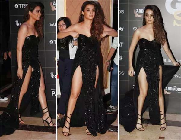 surveen chawla adjust dress at gq style awards