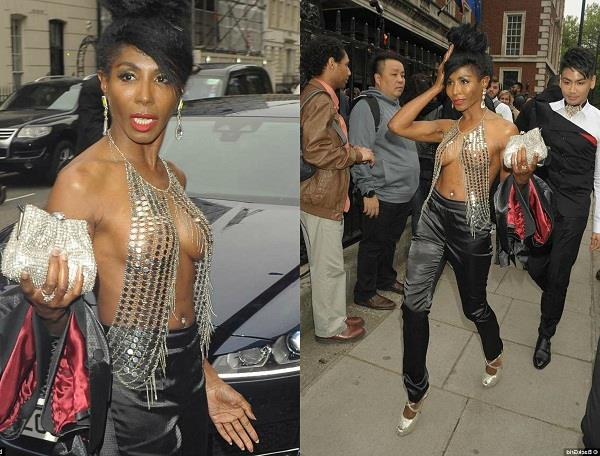 sinitta turns heads as she wears a very daring metallic bralette