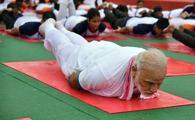 PunjabKesari Make Yoga a part of your life Modi