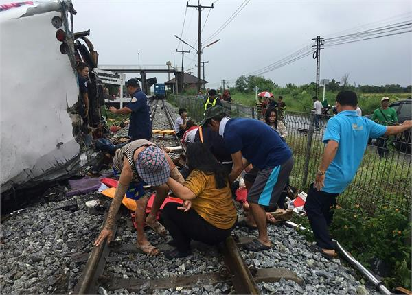 thailand bus crash at least 17 killed in collision with train