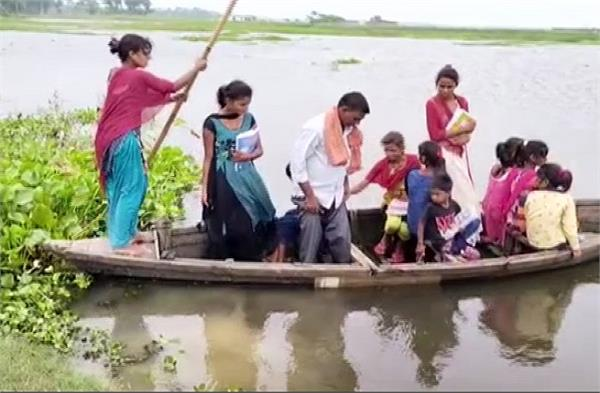 children forced to go to school by boat