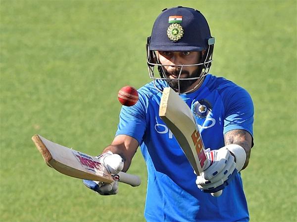 PunjabKesarisports virat Kohli bat ball image