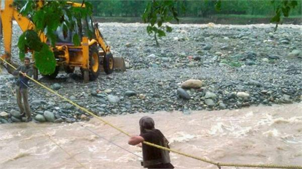 jcb and truck captured in samba river water