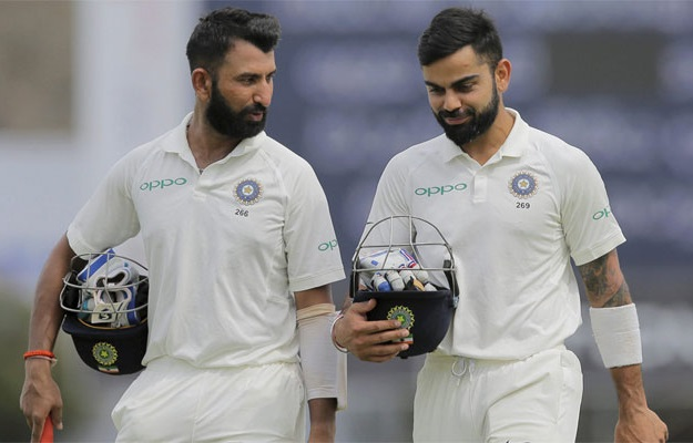 pujara and kohli image