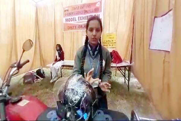 PunjabKesari, Student With Smart Helmet Model Image