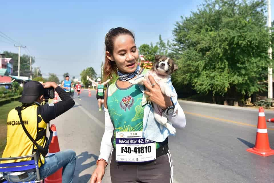 Marathon Runner Khemjira With Puppy