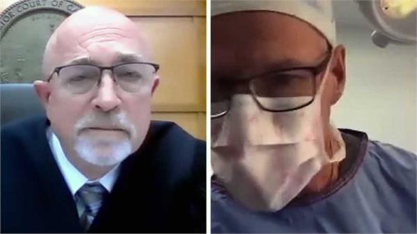 us doctor appears in court video call while performing surgery