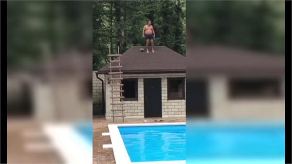 drunken rooftop pool jump goes horribly wrong