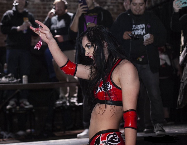 Priscilla Kelly shoving her tampon down opponent's throat