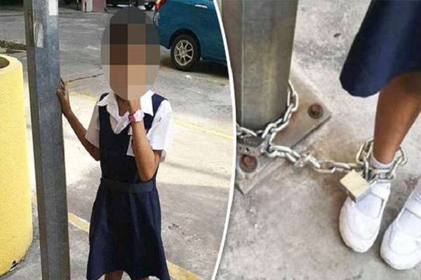 eight year girl is chained to a pole by her mother