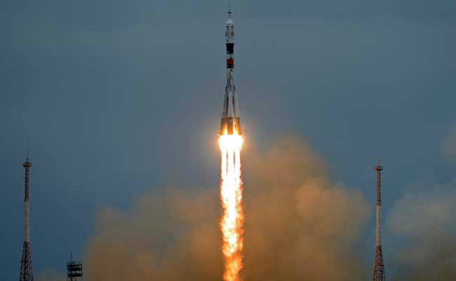 two russians one american crew blast off for international space station
