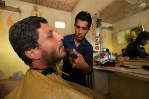 mosul business is booming for one barber after liberation