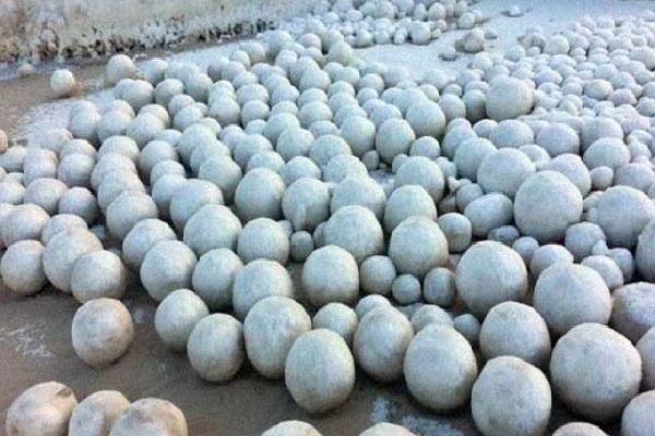 striking snowballs appear on beach in siberia