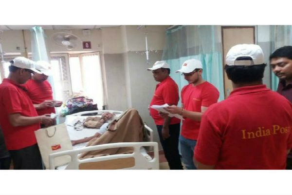 praiseworthy step of the indian post office team exchanging currency in hospitals