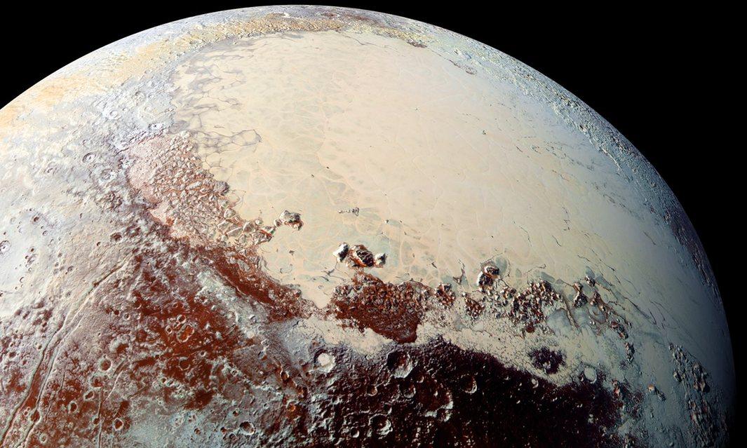 plutos frozen surface may hide a vast liquid ocean