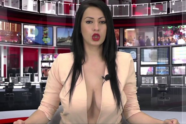 topless woman when the news anchor read the news on tv view photos
