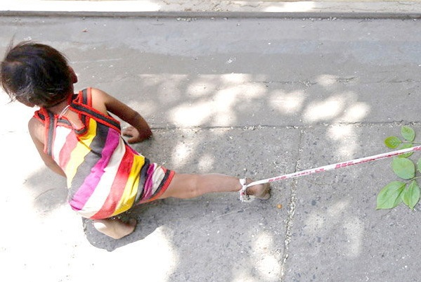 in ahmedabad parents tie toddler to rock while they work