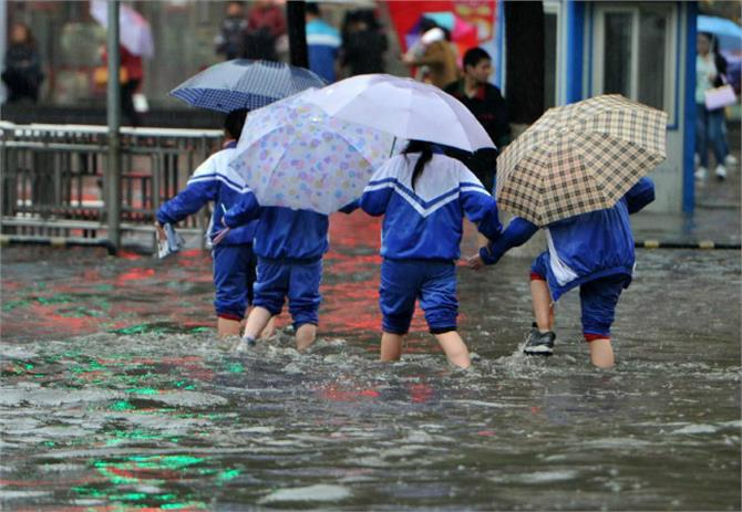 china issues blue alert for heavy rain