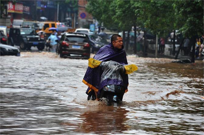 13 dead 13 missing in china rain landslides