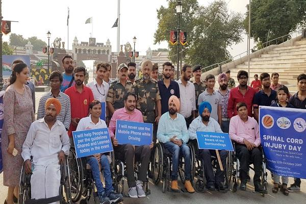 100km on wheel chairs walk to safety