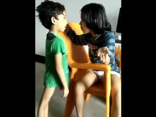 girl teaching his brother good habits on toilet