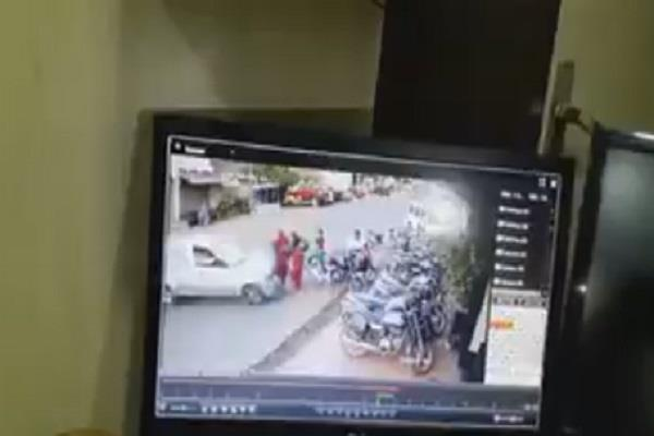 two women bouncing in the air by car collision