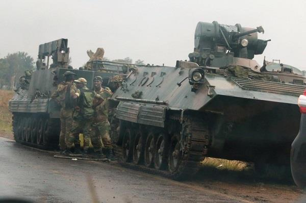 blasts reported after military vehicles seen on harare outskirts