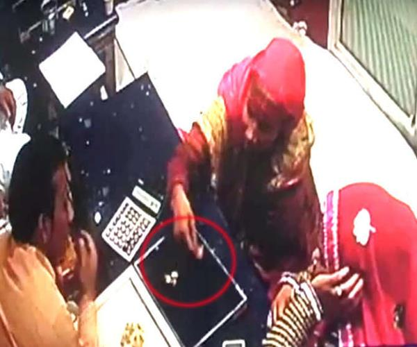 jewelry stolen from vicious form  handcuffed women in cctv