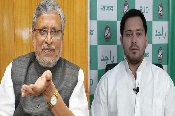 dispute in the assembly between modi and tejaswi
