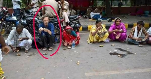 viral photo the white man eating on the street is jean