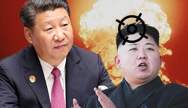 world s focus on north korea china continues south china sea buildup