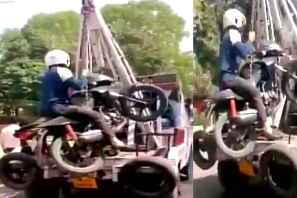 traffic police towed a man along with bike