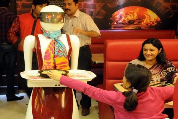 pakistan first robot waiter starts serving pizza in multan restaurant