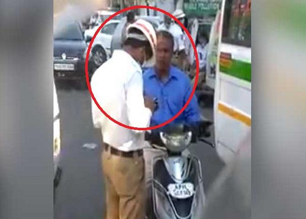 hyderabad cop caught on camera taking a bribe