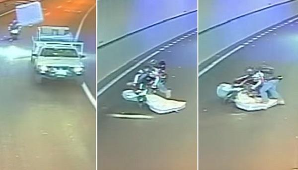 flying mattress hits biker but also saves his life