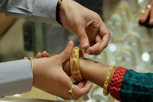 gold loses ground on demand decline  silver bounces