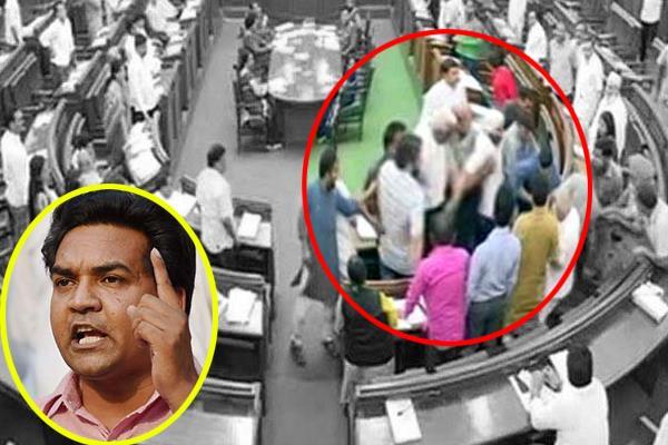 kapil mishra marshalled out of delhi assembly