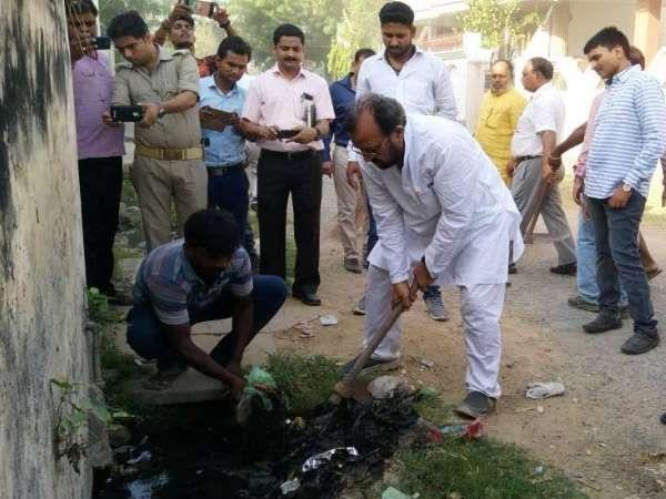 yogi effect minister visits kashi to inspect cleanliness clean drain