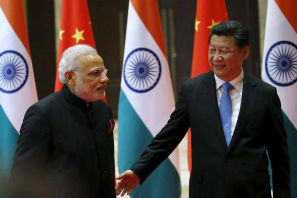 india should not overly interpret beijing military build up says chinese daily