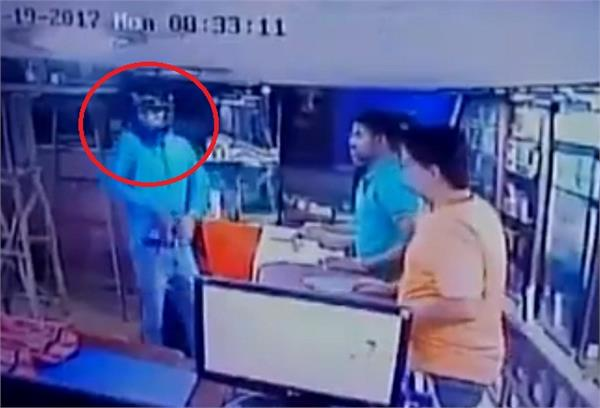 unidentified armed man opens fire inside a showroom in rajasthan
