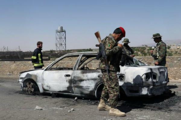 dozens killed or wounded in attack on afghanistan police headquarters