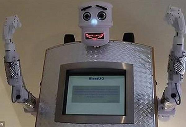 a  robot priest  gives blessings in germany
