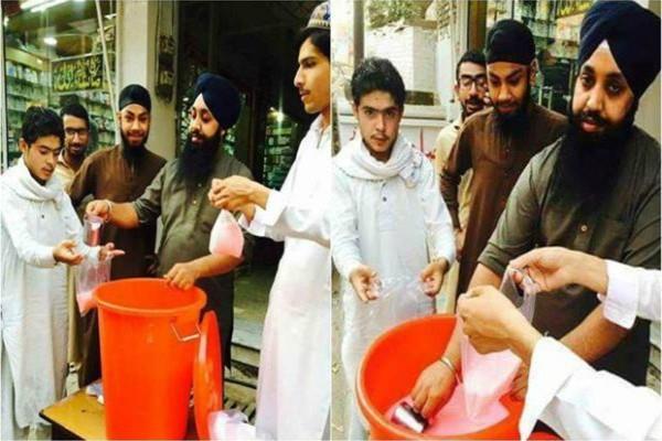 sikh men serving rooh afza milk to fasting muslims in peshawar