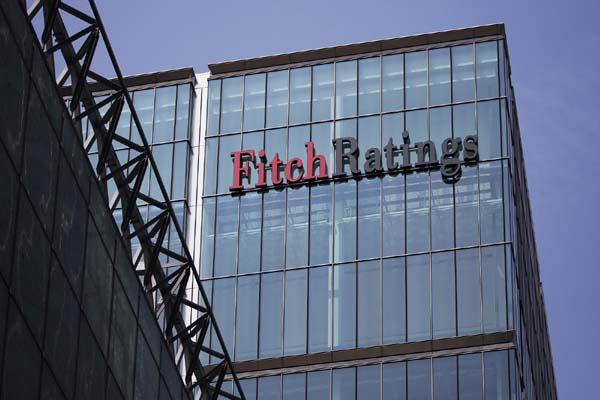 cash crunch led to   material impact on spending    says fitch