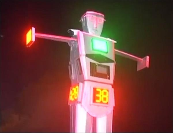 a 14 feet robocop directs traffic in indore