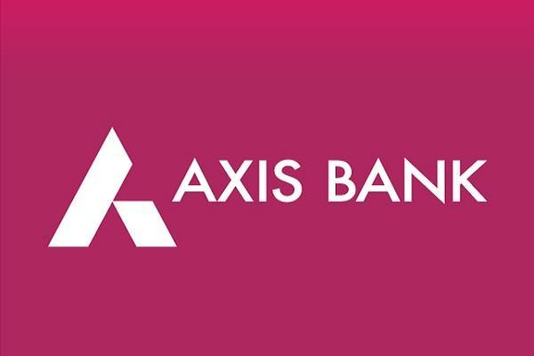 axis bank  s profit slashed  interest income increased