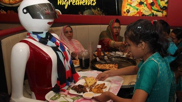 pakistan enchanted by first robot waitresses